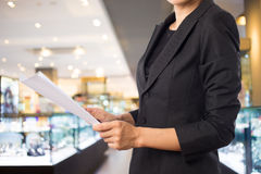 Businesswoman reading a business document. Royalty Free Stock Photography