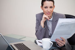 Businesswoman reading company's notification Stock Photography