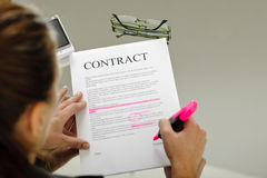 Businesswoman reading contract Royalty Free Stock Photography