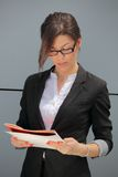 Businesswoman reading contract Royalty Free Stock Photo