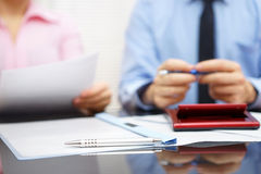 Businesswoman is reading contract to businessman in blur backgro Royalty Free Stock Image