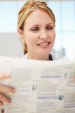 Businesswoman reading document. Businesswoman reading documant smiling off camera Stock Photography