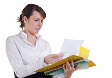 Businesswoman reading a document Stock Images