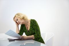 Businesswoman reading document Stock Photo