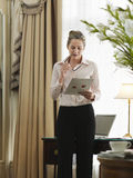 Businesswoman Reading Document In Home Office Royalty Free Stock Images
