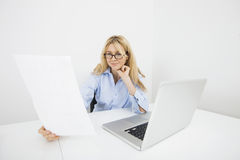Businesswoman reading document in office Royalty Free Stock Image