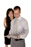 Businesswoman is reading document over a businessman shoulder Stock Photography