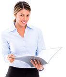 Businesswoman reading documents Stock Photo