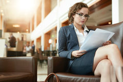 Businesswoman reading documents at cafe Royalty Free Stock Image