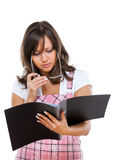 Businesswoman reading documents Stock Photography