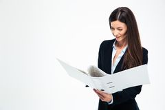 Businesswoman reading documents in folder Royalty Free Stock Photos