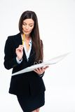 Businesswoman reading documents in folder Royalty Free Stock Photography