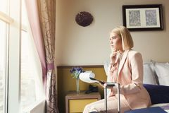 Businesswoman reading documents in hotel. Businesswoman reading documents. Female professional in hotel examining papers. Business lady go to business trip, copy Royalty Free Stock Images
