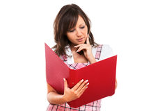 Businesswoman reading documents Stock Images