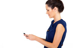 Businesswoman reading email. Smart young businesswoman reading email on smart phone Royalty Free Stock Photos
