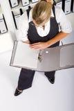 Businesswoman reading file Stock Photo