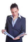 Businesswoman reading a file Royalty Free Stock Photos
