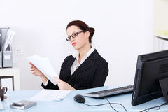 Businesswoman reading files. Royalty Free Stock Image