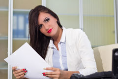 Businesswoman reading files Stock Photos