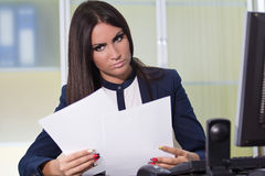 Businesswoman reading files Stock Photos
