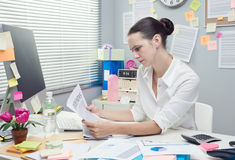 Businesswoman reading financial news Stock Photography