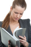 Businesswoman reading a folder Stock Photo