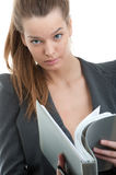 Businesswoman reading a folder Stock Image