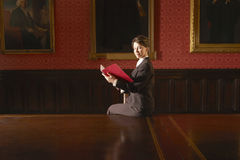 Businesswoman Reading Folder In Conference Room Royalty Free Stock Photography