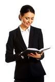 Businesswoman reading her notes Stock Photos
