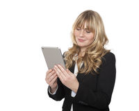 Businesswoman reading her tablet-pc Royalty Free Stock Images