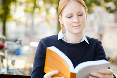 Businesswoman Reading for Leisure or Study Royalty Free Stock Photography