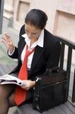 Businesswoman reading magazine Stock Photo