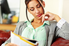 Businesswoman reading magazine Royalty Free Stock Photos