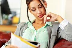 Businesswoman reading magazine Royalty Free Stock Photos