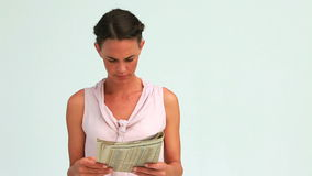 Businesswoman reading the news posing with a smile Royalty Free Stock Image