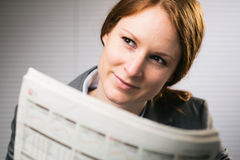 Businesswoman Reading the News Stock Photography