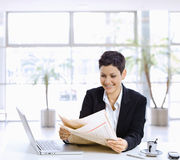 Businesswoman reading newspaper Stock Photography