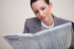 Businesswoman reading newspaper Royalty Free Stock Image
