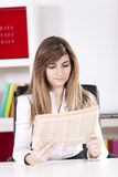 Businesswoman reading the newspaper Royalty Free Stock Photo