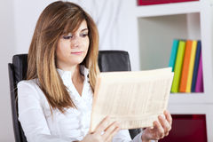 Businesswoman reading the newspaper Stock Image