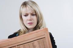 Businesswoman Reading Newspaper Royalty Free Stock Photo
