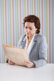 Businesswoman reading the newspaper Stock Photography