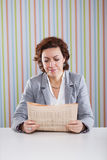 Businesswoman reading the newspaper Royalty Free Stock Images