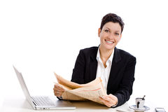 Businesswoman reading newspaper Royalty Free Stock Photo
