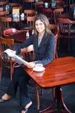 Businesswoman reading newspaper Stock Image