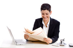 Businesswoman reading newspaper Stock Image