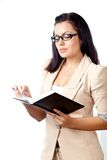Businesswoman reading notebook Royalty Free Stock Images