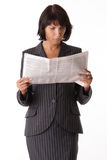 Businesswoman reading the paper Royalty Free Stock Photos