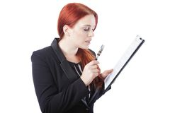 Businesswoman Reading Report with Magnifying Glass Stock Photo