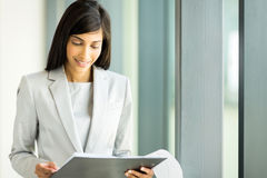 Businesswoman reading report Royalty Free Stock Image